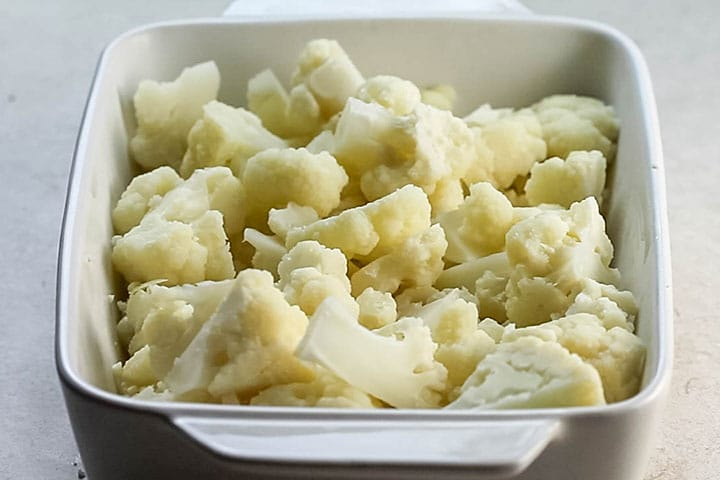 Steamed cauliflower in a baking pan