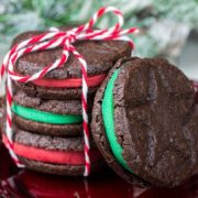 A stack of Homemade Oreo Christmas Cookies with one leaning against them