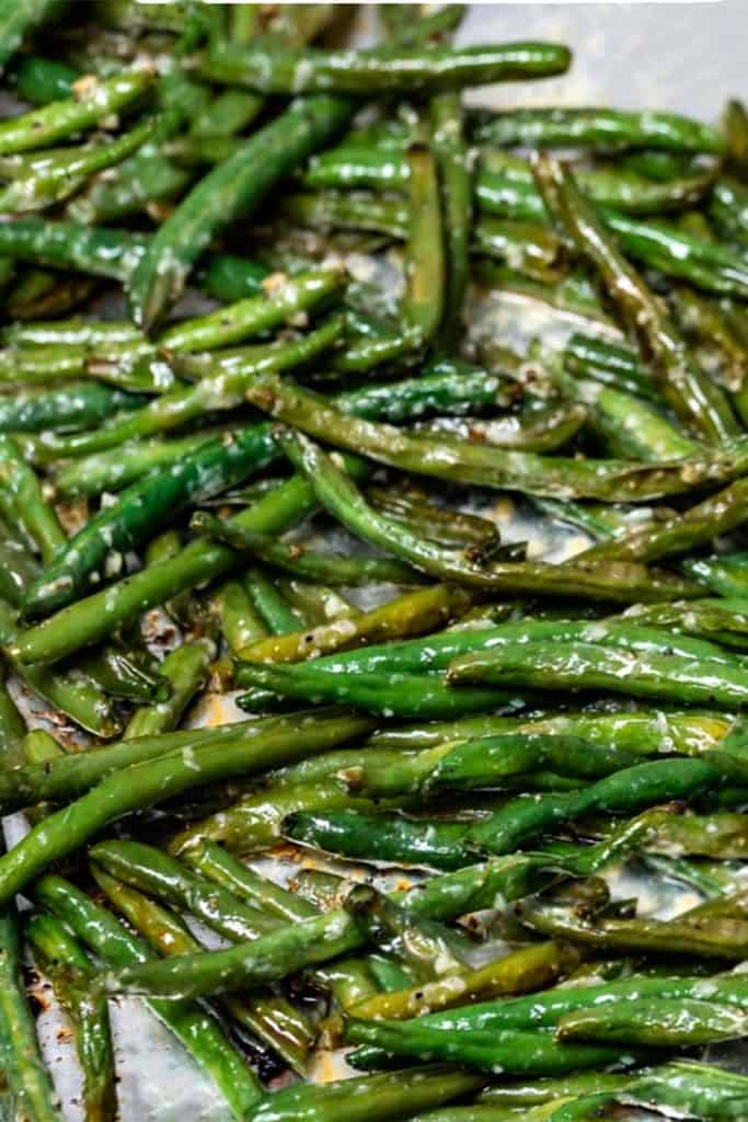 roasted green beans just out of the oven crispy and browned