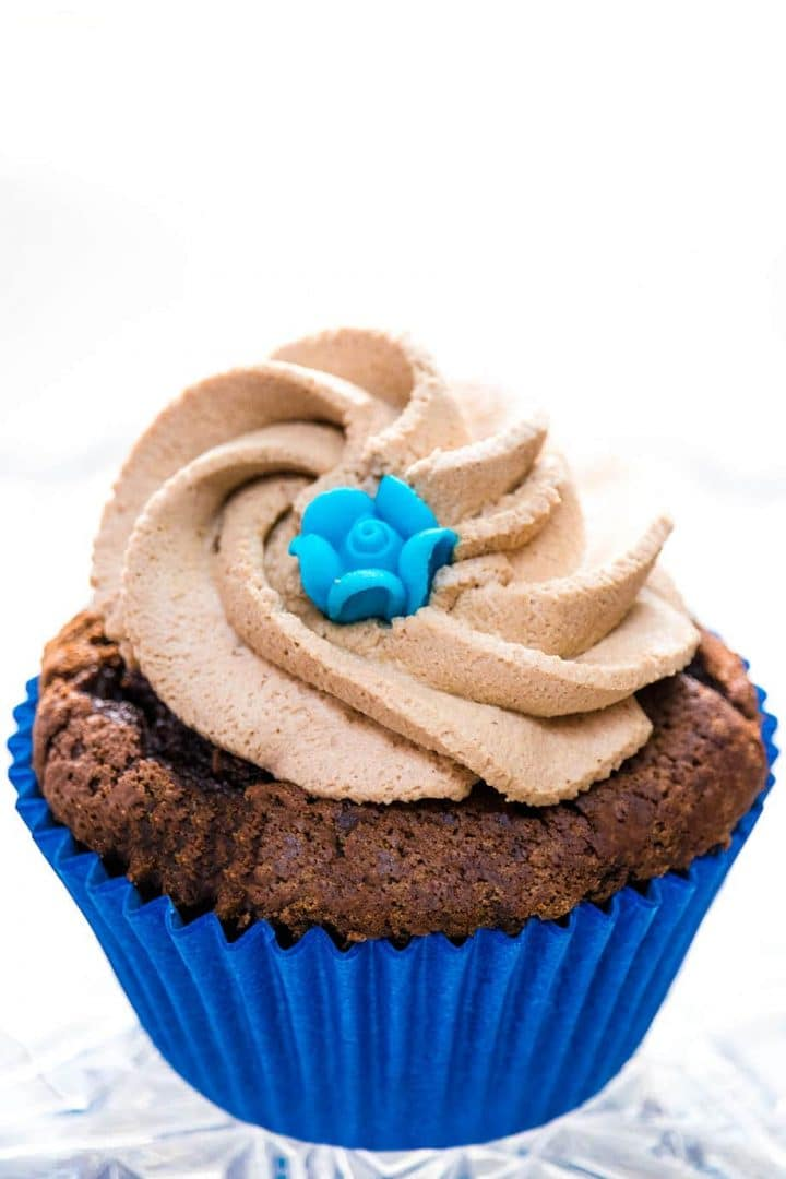 a chocolate cupcake with a swirl of Chocolate Whipped Cream Frosting