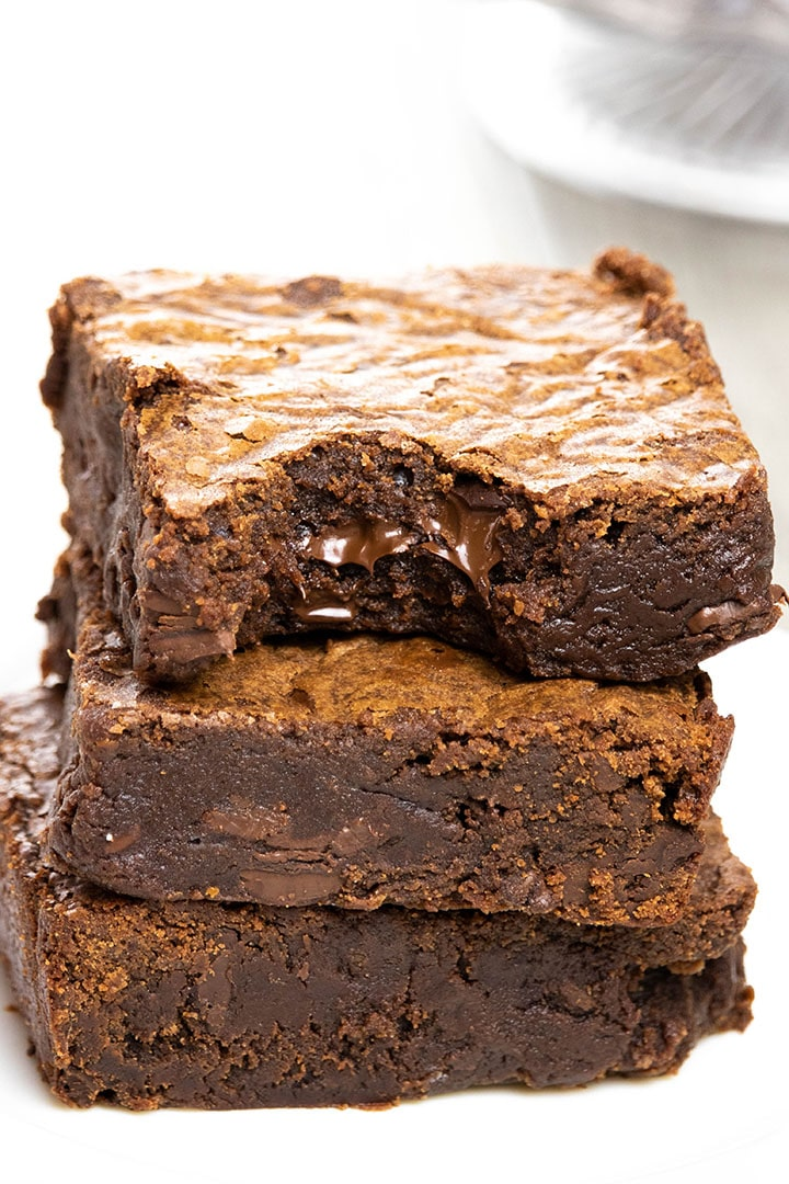 Easy Chocolate Brownies stacked 3 high with a bite taken from the top one