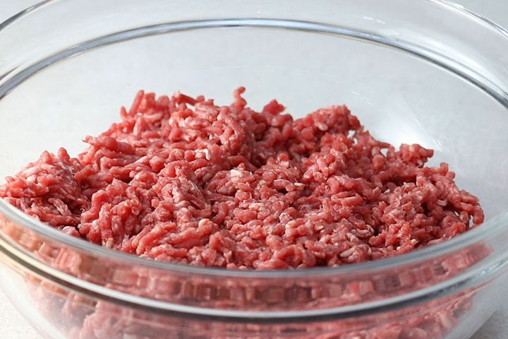 Ground beef in a large mixing bowl