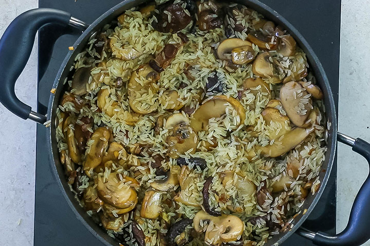 The rice added to the pan with the mushrooms