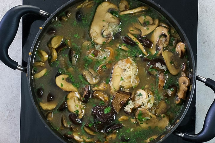 The stock added to the mushroom and rice