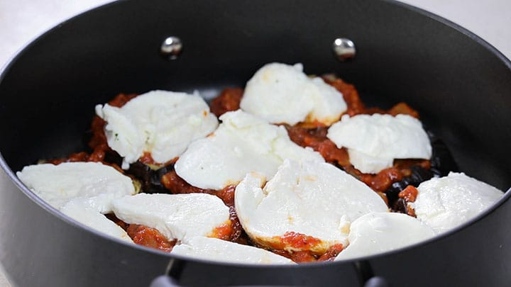 mozzarella slices topping the eggplant and sauce