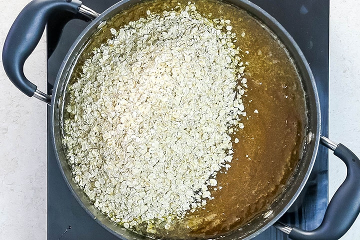 the oats added to the syrup mixture in the pan