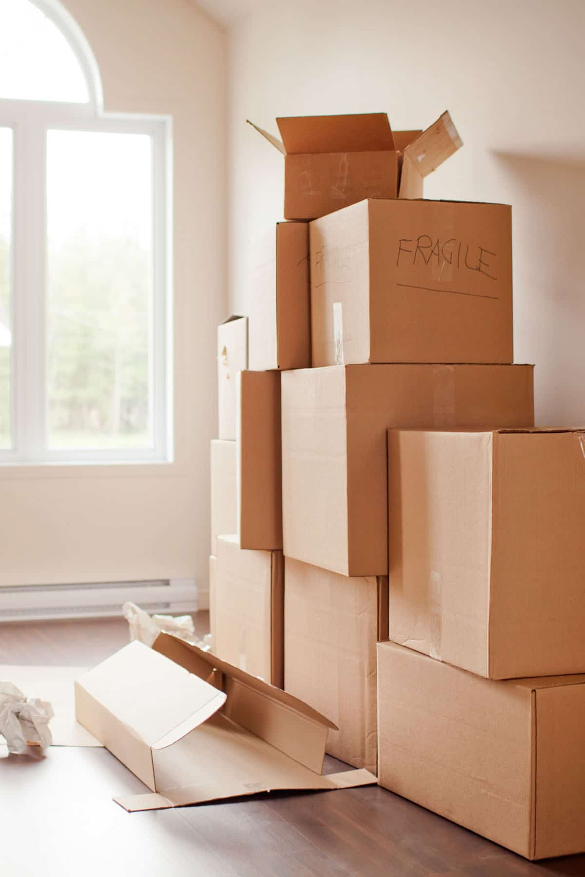 a picture of boxes stacked in an empty room