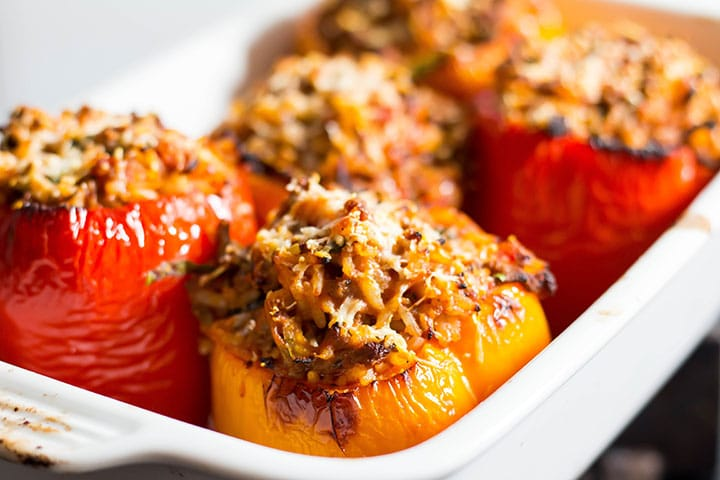 the stuffed peppers right out of the oven with golden tops