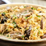 a close up of easy mushroom rice pilaf in a serving dish