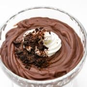 Homemade Dark chocolate pudding topped with shaved chocolate and whipped cream