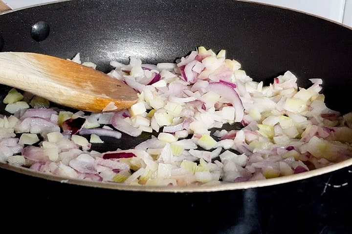 chopped onions cooking in a pan