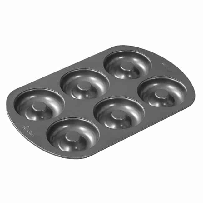 a six cavity donut pan with a white background