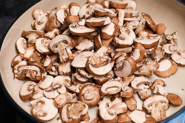 a pan with sliced mushrooms