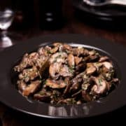 Easy Sautéed Mushrooms in a bowl with a serving spoon