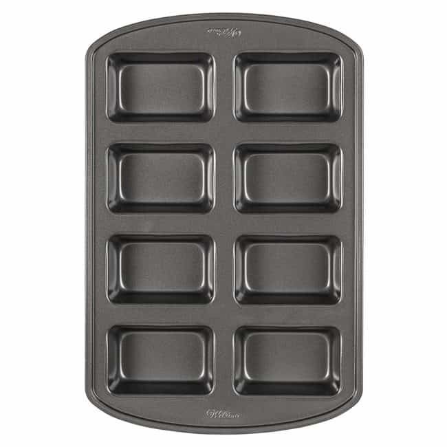 a Wilton Mini Loaf Pan with a white background