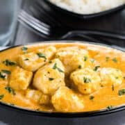 Chicken Korma in a serving dish sprinkled with fresh corriander