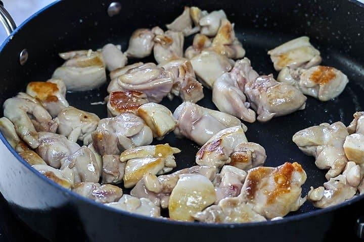 Chciken browning in the pan