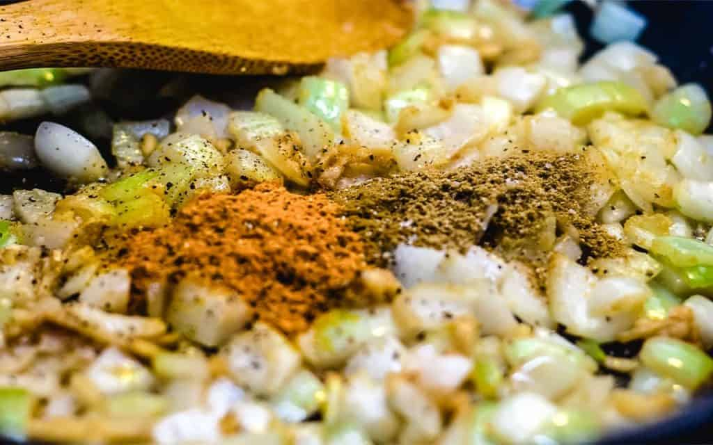 The spices added to the onion mixture