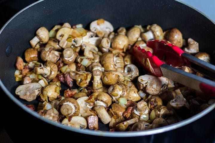 the mushrooms added to the pan with the pancetta mixture