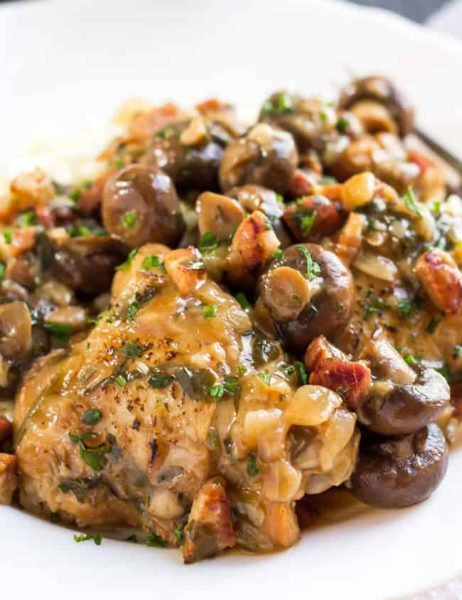 Chicken with Sherry Mushrooms Sauce piled high on a white plate