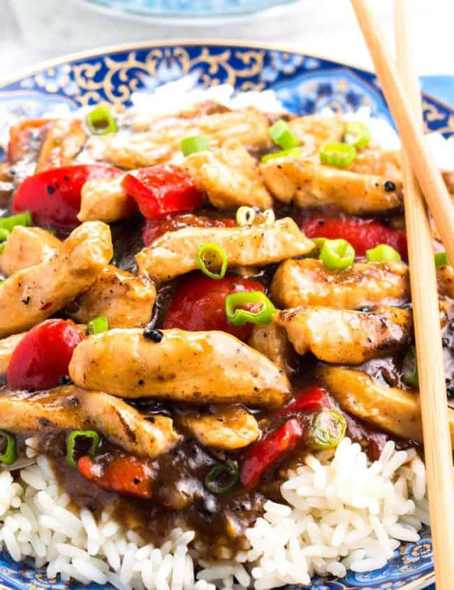 Chicken with Black Bean Sauce piled high on a bed of rice
