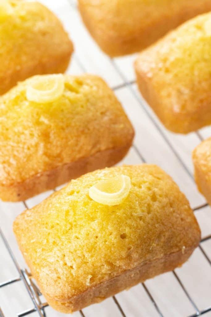 mini lemon drizzle cakes on a cooling rack