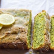 Lemon Poppy Seed Drizzle Cake with three slices cut out of it