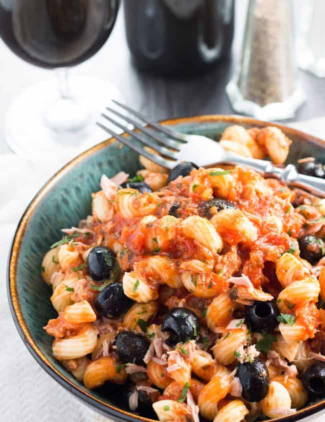 Curly Pasta with Tuna and olives in tomato sauce served in a bowl