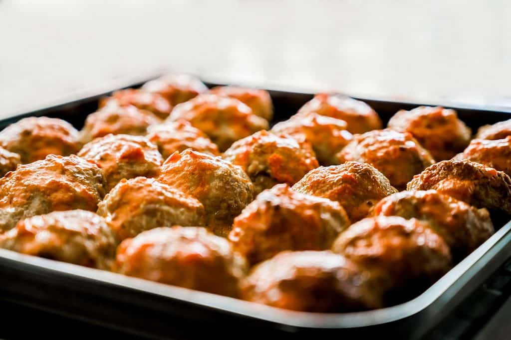 oven cooked meatballs on a baking tray