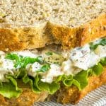 a close up of A tuna salad sandwich with lettuce