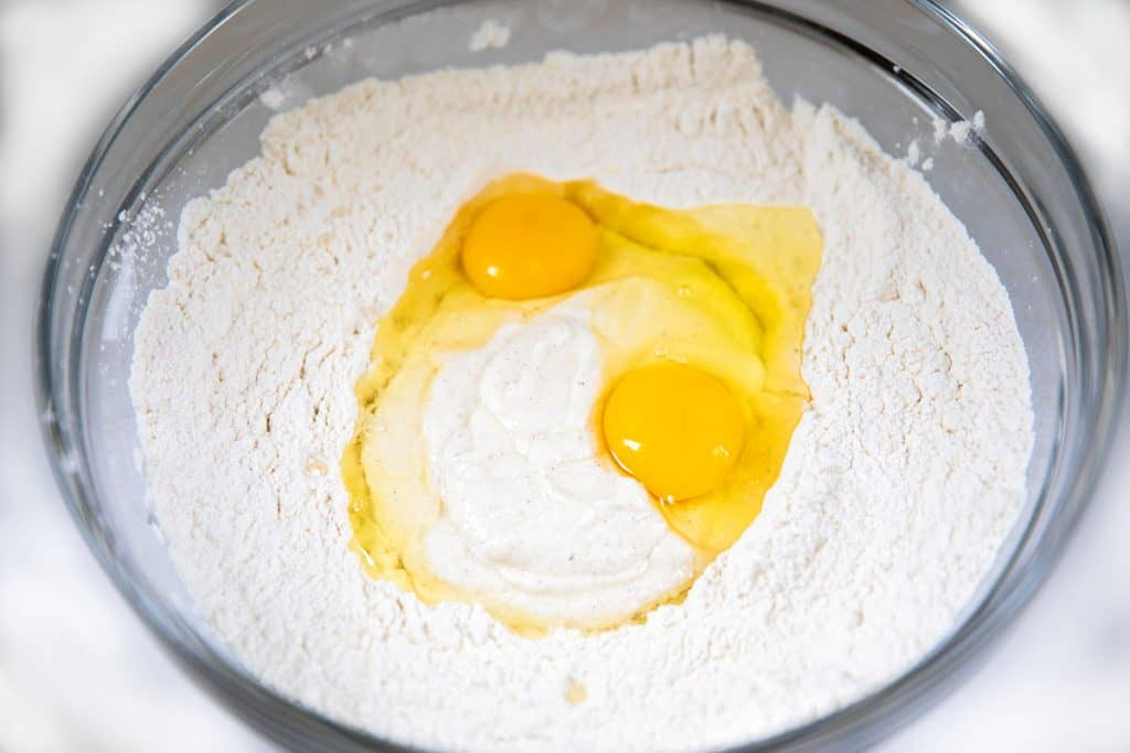 the sour cream mixture and eggs added to the dry ingredients in a bowl