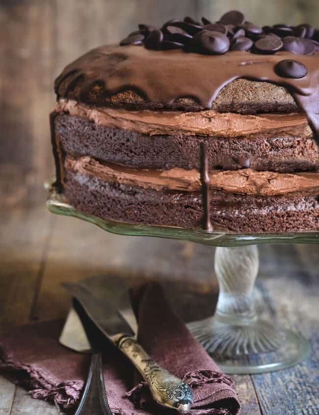 Chocolate cake with chocolate buttercream with a rustic background.