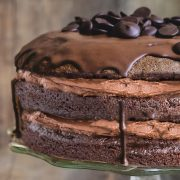 a close up of Chocolate cake with chocolate buttercream with a rustic background.