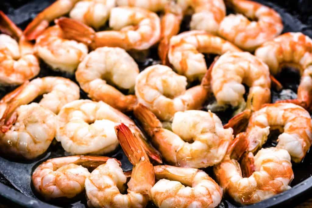cooked shrimp in a pan with butter