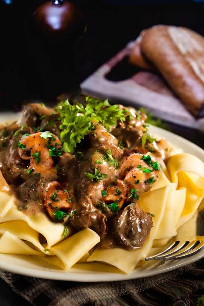 Beef and mushrooms in a creamy sauce over noodles