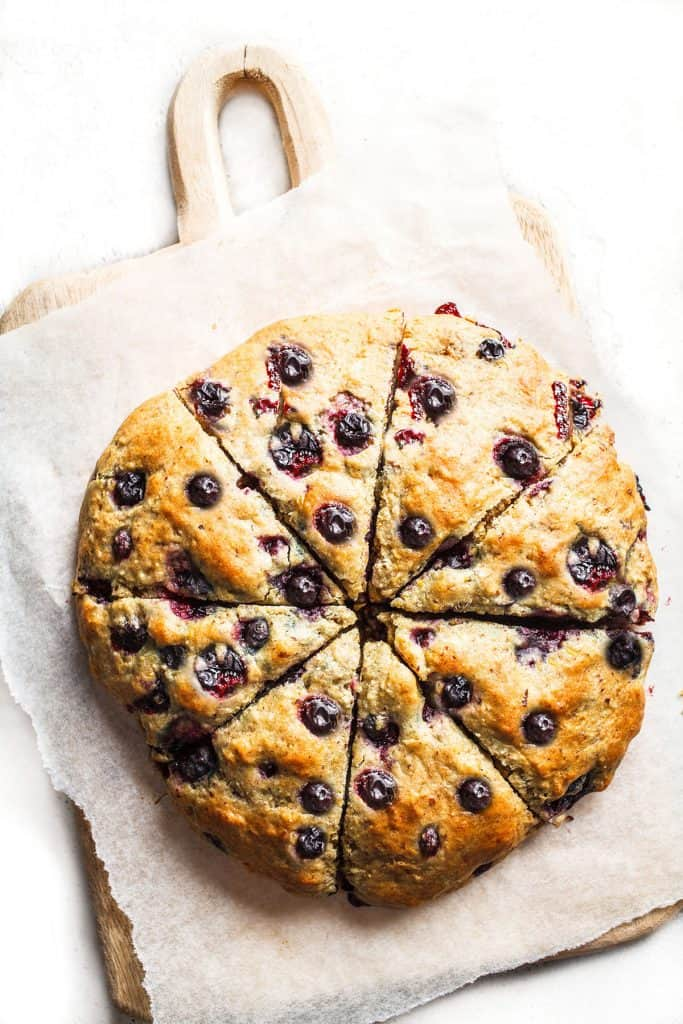 A batch of fresh blueberry scones sliced into wedges