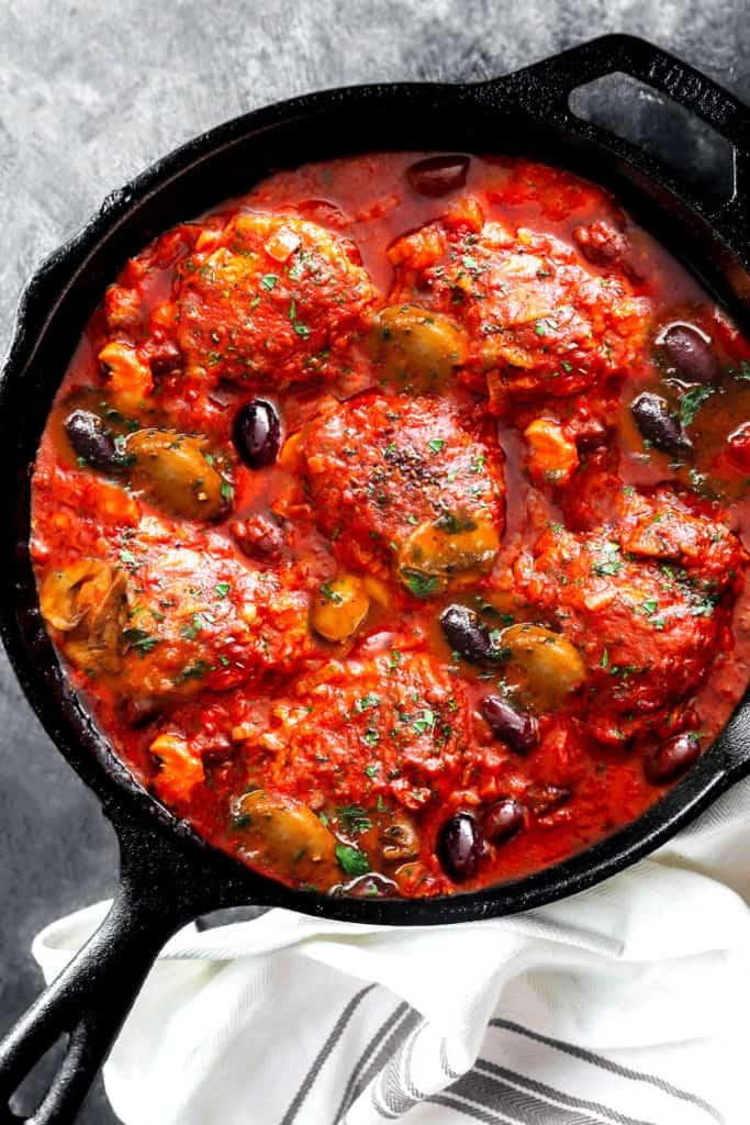 an overhead shot of chicken cacciatore in a pan