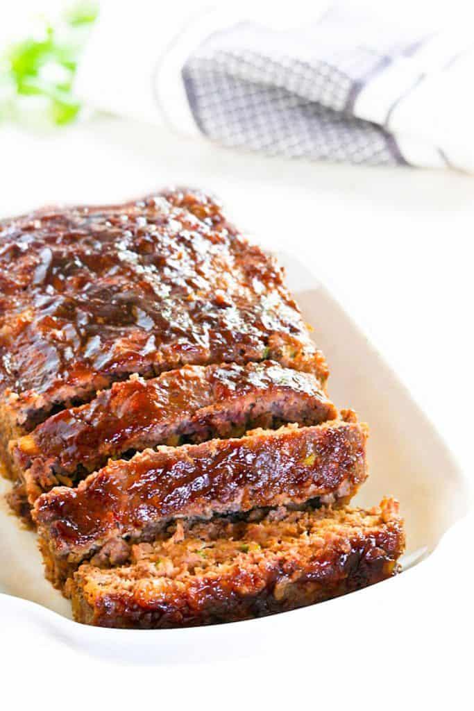 a sliced meatloaf on a serving dish