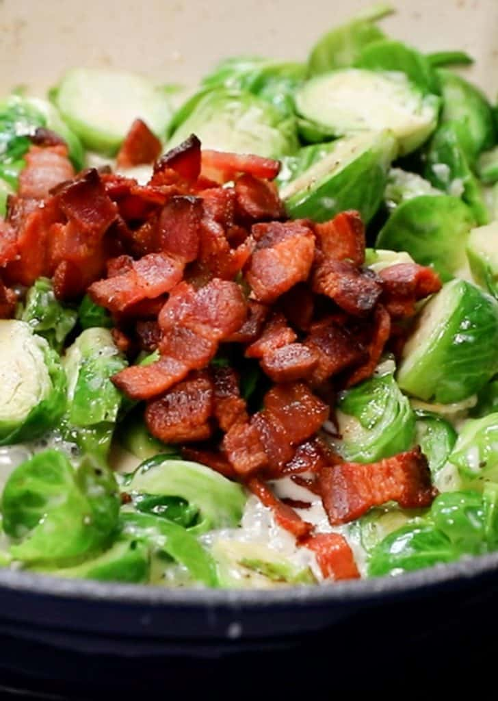 Chopped bacon added to the pan with the brussels sprouts mixture