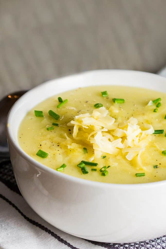 potato leek soup topped with chopped chives and grated cheddar