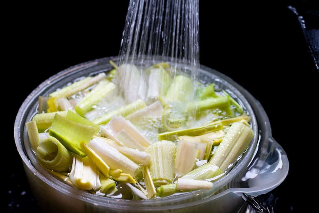 leeks being cleaned with water