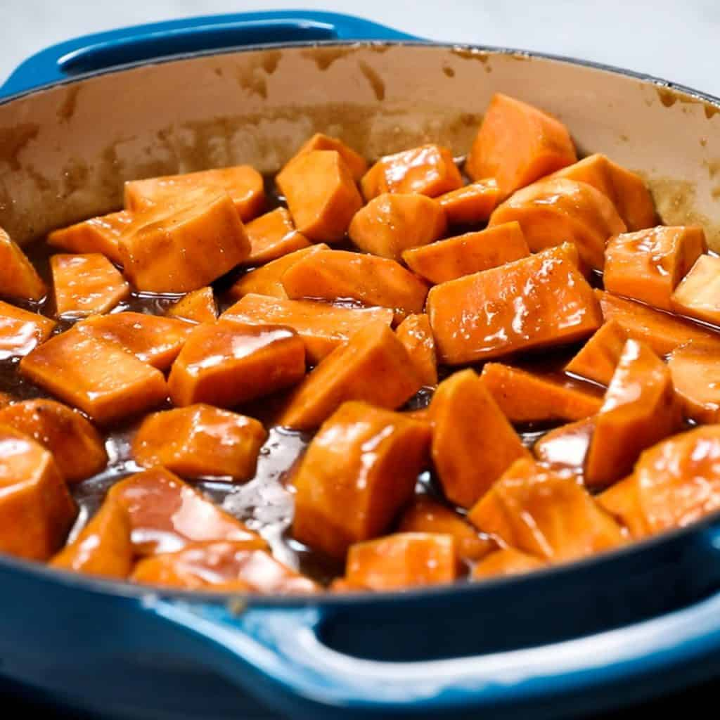 the sweet potatoes added to the pan with the sauce