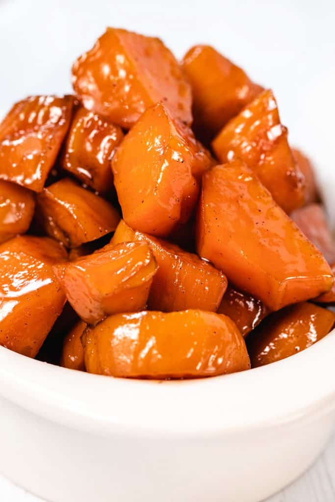 candied sweet potatoes piled high in a dish