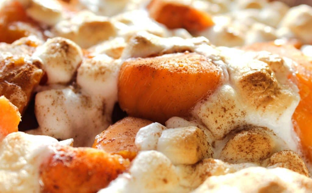 Close up of sweet potatoes with cinnamon and marshmallows