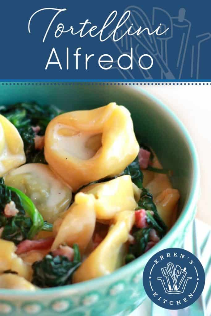 A bowl of Tortellini with cream sauce, spinach and bacon bits