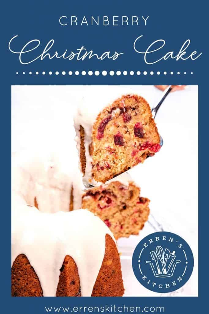 a slice of cake being cut out of the cranberry christmas cake