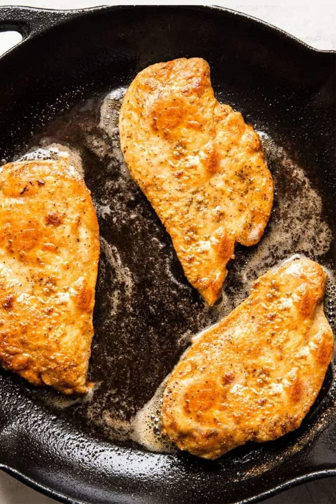 flied chicken breasts in a pan