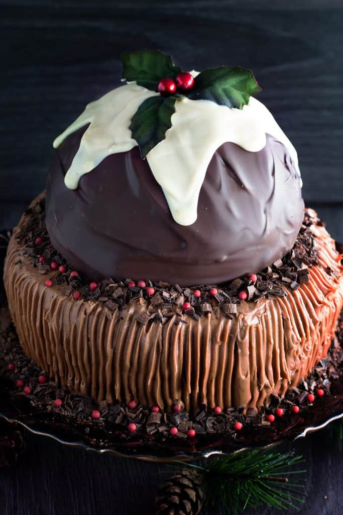 a chocolate cake topped with a christmas pudding made out of chocolate