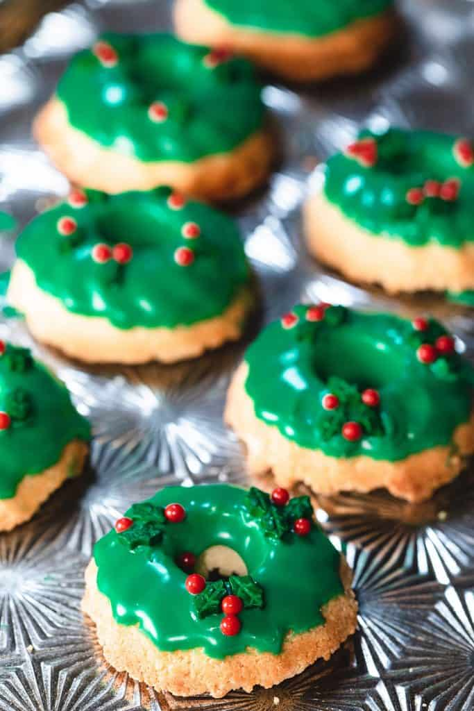 two rows of Christmas Wreath Cookies on a silver baking tray
