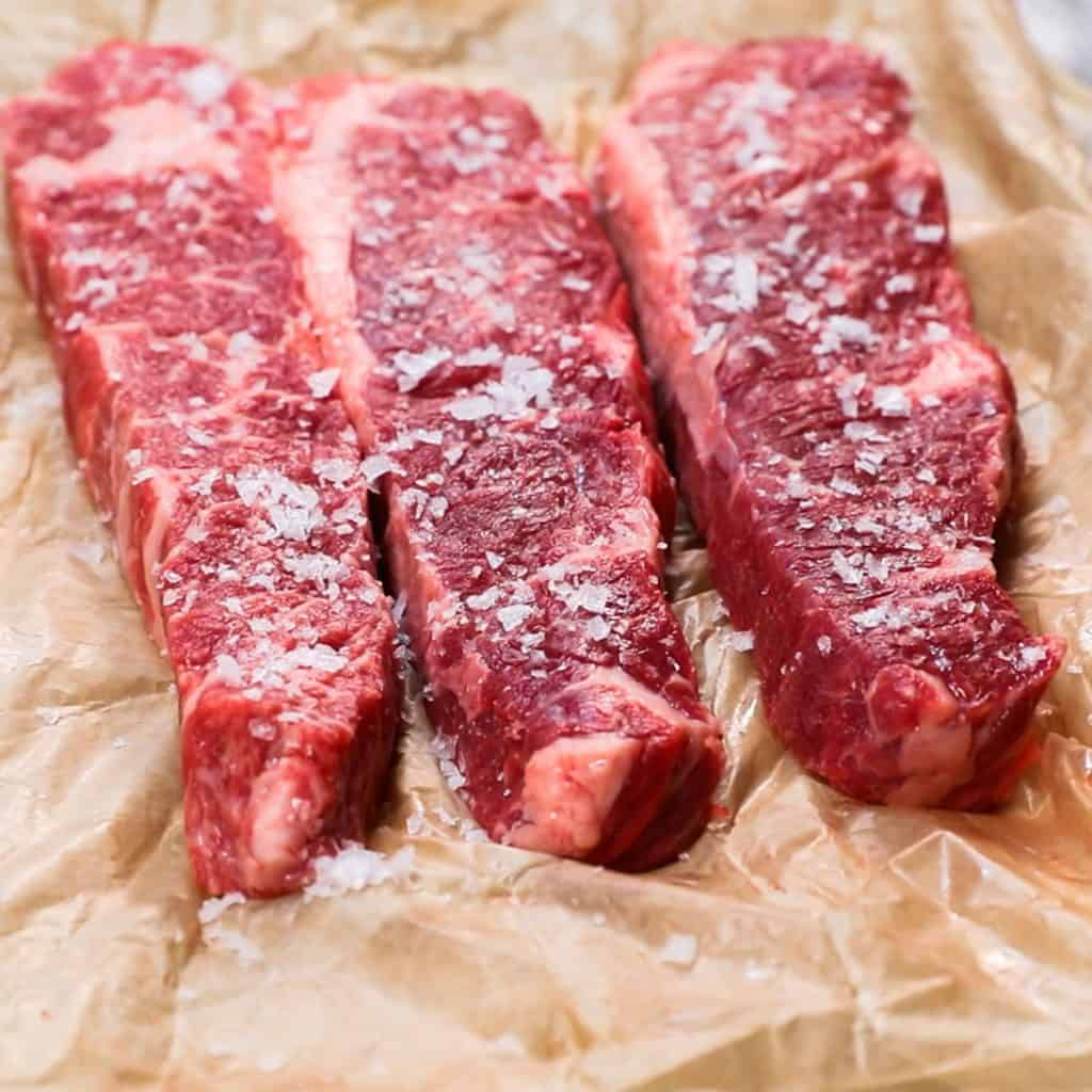 salted raw short ribs on butcher paper